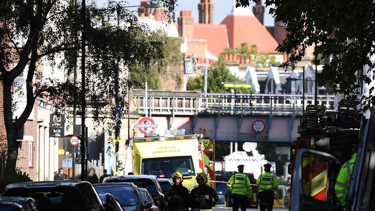 The emergency services are seen near the police cordon at Parsons Green