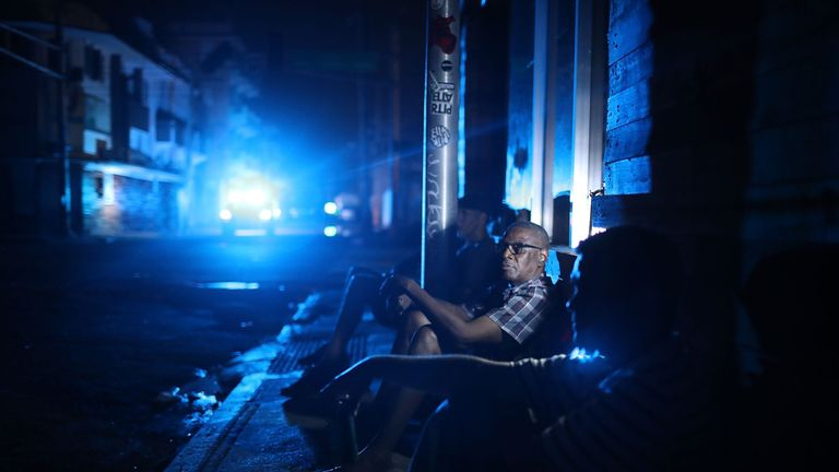 Jaime Degraff sits outside as he tries to stay cool as people wait for the damaged electrical grid to be fixed after Hurricane Maria passed through the area on September 23, 2017 in San Juan, Puerto Rico