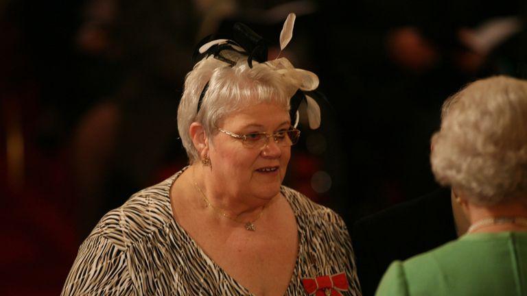 Penelope Jones pictured with the Queen in 2010
