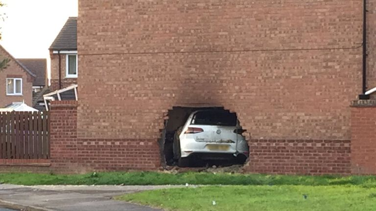 Four people were injured after a VW Golf crashed through a wall into a house. Pic: MinsterFM