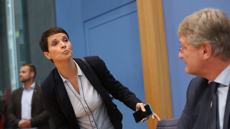 Frauke Petry storms out of a news conference in a joint news conference with other party leaders