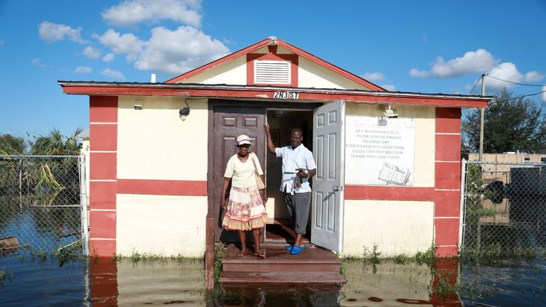 Pastor Louicesse Dorsaint stands with his wife Maria in front of their church, Haitian United Evangelical Mission in Immokalee, Florida