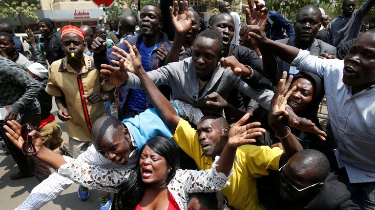 Opposition supporters cheer outside the court after President Uhuru Kenyatta's election win was declared invalid