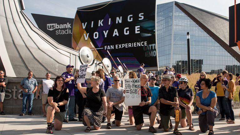 Protesters kneel outside U.S. Bank Stadium before the Minnesota Vikings game in Minneapolis, Minnesota.