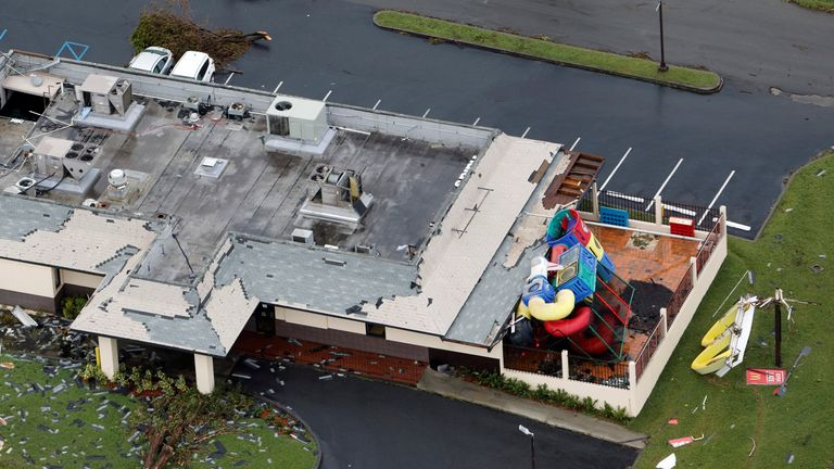 Roof shingles, a playground and the sign of a restaurant lie scattered on hurricane-battered St. Croix, U.S. Virgin Islands