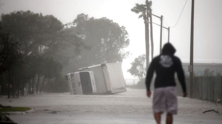 A truck is turned over as Hurricane Irma passes Miami