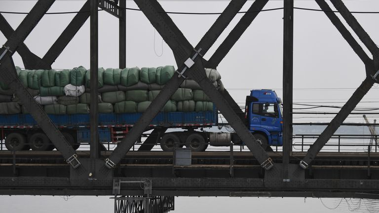 A truck loaded with goods makes its way across the Friendship Bridge from China to the North Korean town of Sinuiju