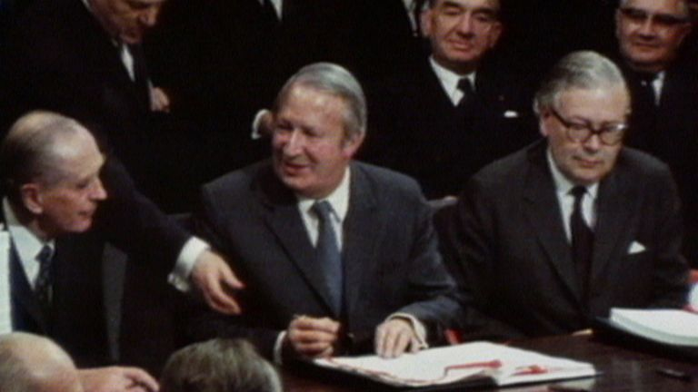 Edward Heath signing Britain in to the EU.
