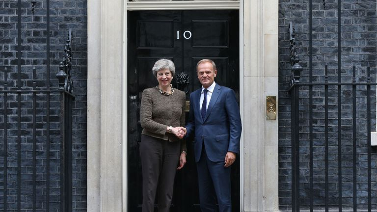Theresa May greets European Council President Donald Tusk at Downing Street