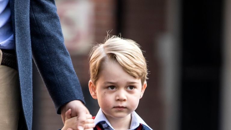 Prince George arrives with the Duke of Cambridge at Thomas's Battersea in London