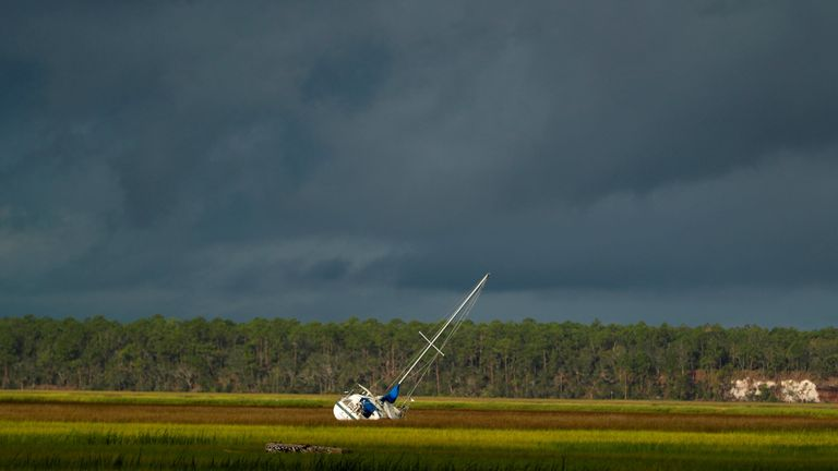 A boat is seen after being blown from the dock into the marsh after Hurricane Irma passed through in St Marys, Georgia