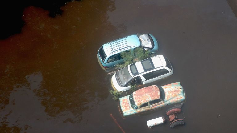 Cars sit up to their engines in standing water in Orange, Texas