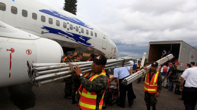 Rescue members of the Permanent Contingency Commission of Honduras (COPECO) make final arrangements before departing for Mexico