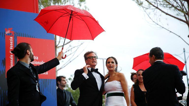Colin Firth and his wife Livia Giuggioli arrive for the Franca Sozzani Award ceremony