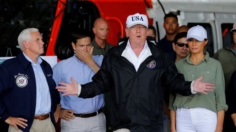 Donald Trump talks to reporters while receiving a briefing on Hurricane Irma relief efforts in Fort Myers