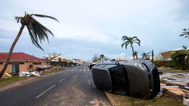A car turned onto its side in Marigot, near the Bay of Nettle, on the French Collectivity of Saint Martin
