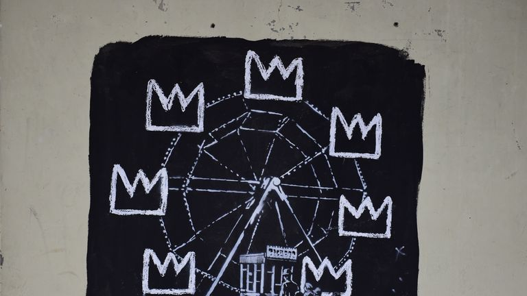 One of two new murals painted by the artist Banksy near the Barbican Centre in London. The works mark the opening of an exhibition by American artist Jean-Michel Basquiat at the arts venue