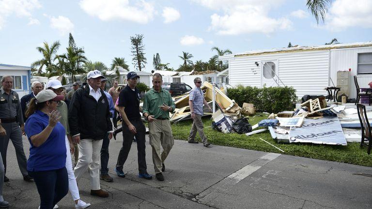Mr Trump tours a neighbourhood affected the hurricane