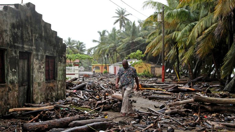 A man walks among debris as Hurricane Irma moves off the northern coast of the Dominican Republic, in Nagua, Dominican Republic, September 7, 2017