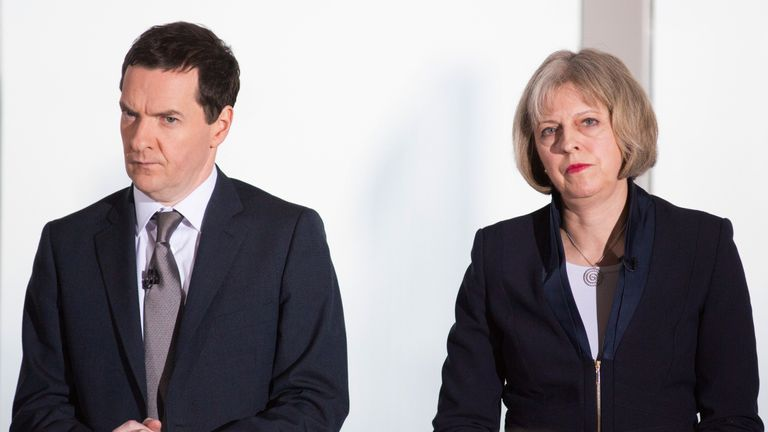 Then Chancellor George Osborne (L) and then British Home Secretary Theresa May (R) attend a Conservative Party press conference in 2015