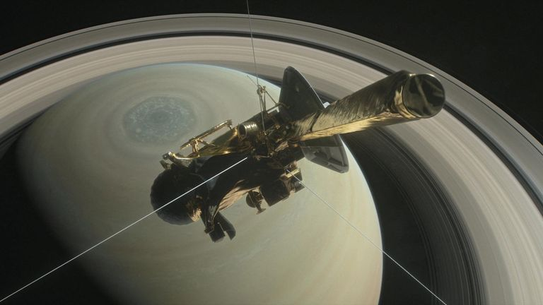 The spacecraft Cassini is pictured above Saturn's northern hemisphere prior to making one of its Grand Finale dives in this NASA illustration
