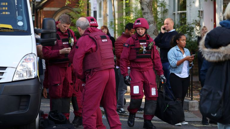 Members of a bomb disposal squad stand in the street near Parsons Green tube station in London