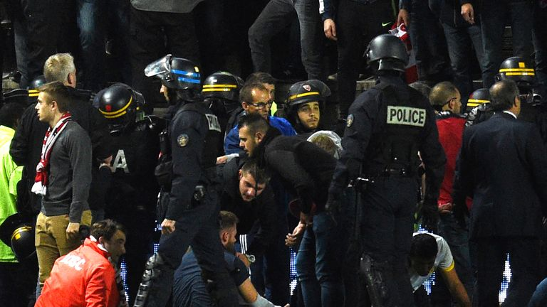Police and stadium staff quickly began to help injured supporters