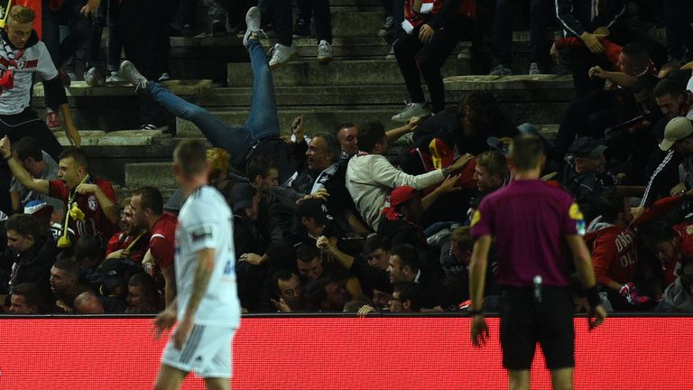 The stadium barrier collapsed as away fans celebrated a goal