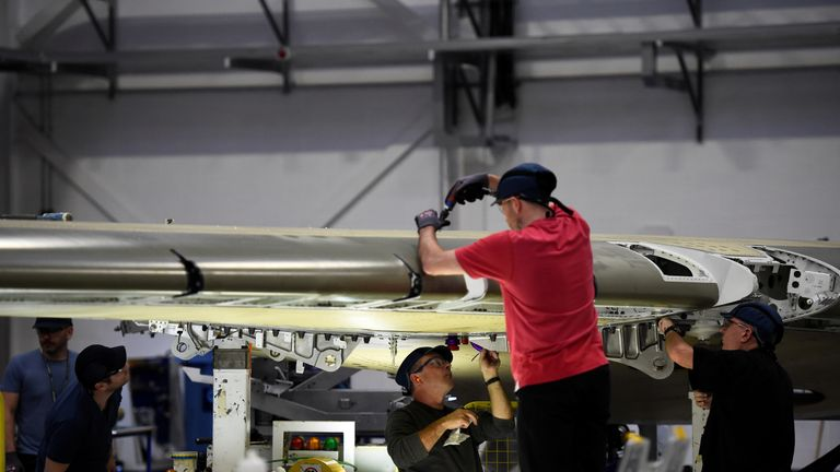 People work on a C Series aeroplane wing in the Bombardier factory in Belfast, Northern Ireland September 26, 2017