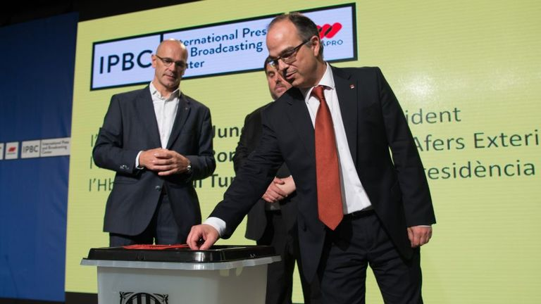 Catalan officials show off the ballot boxes to be used in the disputed referendum