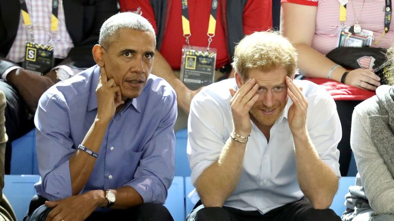 Former U.S. President Barack Obama and Prince Harry chat while watching the Wheelchair Basketball pool match between France and the United States