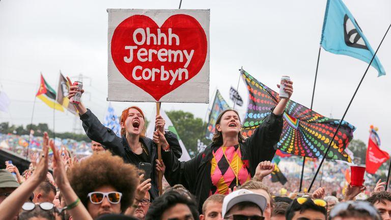 A Corbyn fan chants his name at Glastonbury Festival