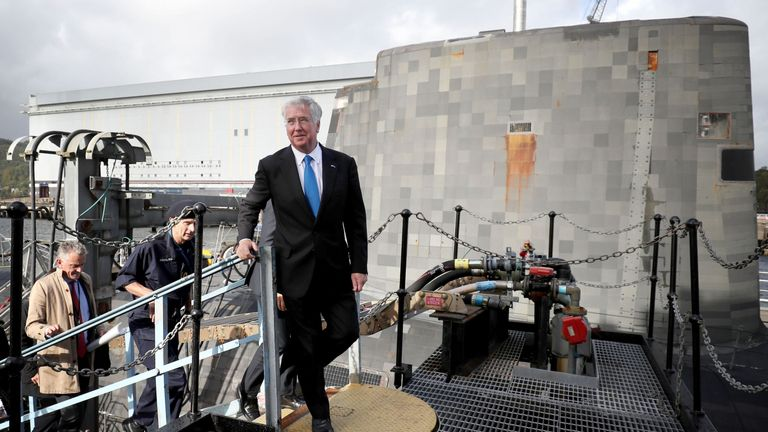 Defence Secretary Sir Michael walks alongside the Vanguard-class nuclear deterrent submarine HMS Vengeance
