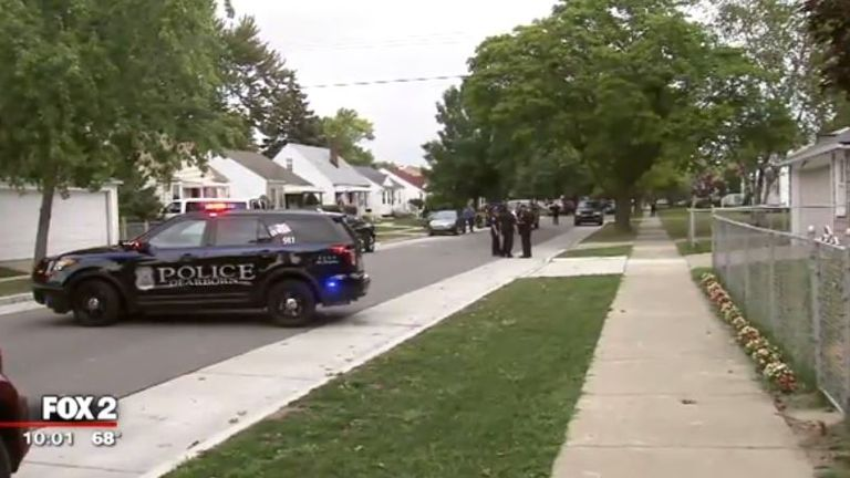 Police vehicles seen near the house. Pic: Fox2