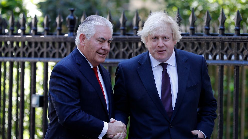 LONDON, ENGLAND - MAY 26: British Foreign Secretary Boris Johnson (R) greets US secretary of state Rex Tillerson, outside Carlton Gardens on May 26, 2017 in London, England. Rex Tillerson has arrived in London to show support for the UK after the Manchester terrorist attack. (Photo by Adrian Dennis-WPA Pool/Getty Images)