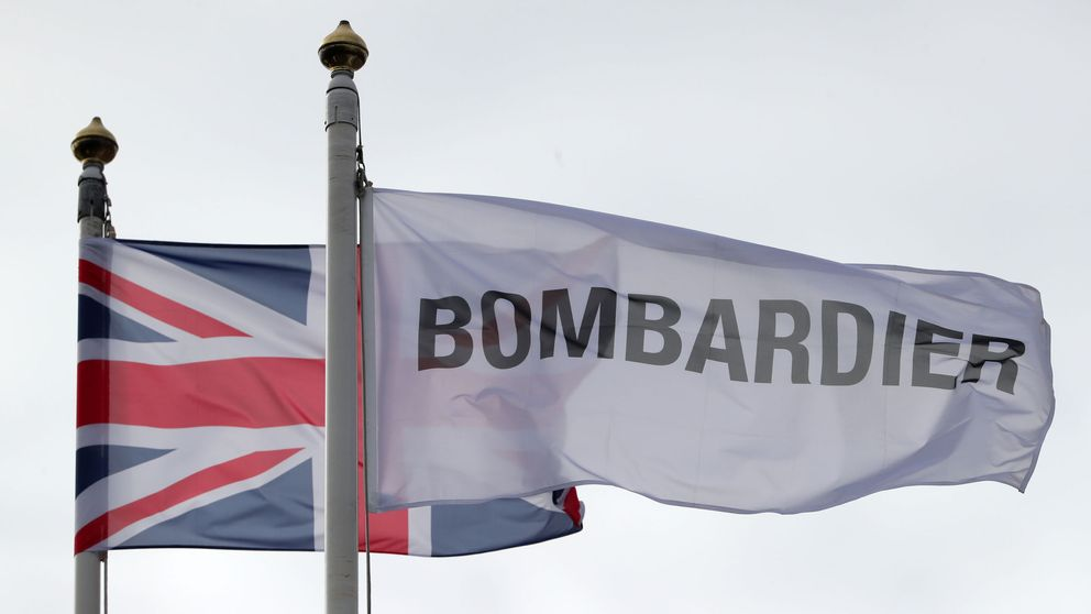 Flags fly above the Bombardier Aerospace plant in Belfast