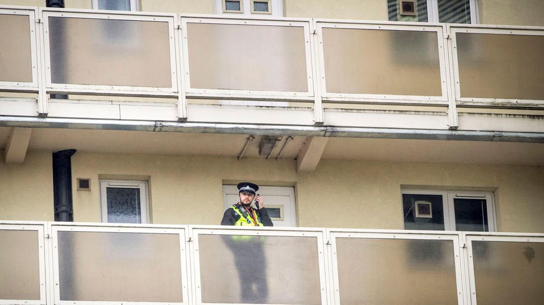 A police officer on a balcony at Newcastle House in Bradford