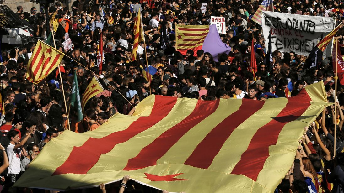 Students carry a pro-independence 'Estelada' flag in Barcelona