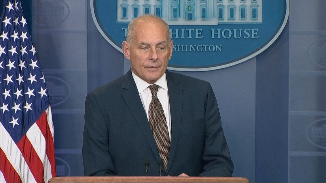 John Kelly tells the gathered media he is not quitting as White House Chief of Staff