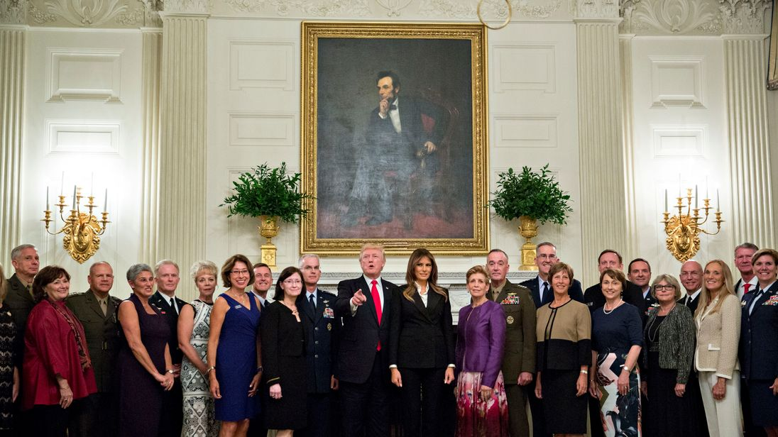 Donald Trump and first lady Melania Trump pose for pictures with senior military leaders