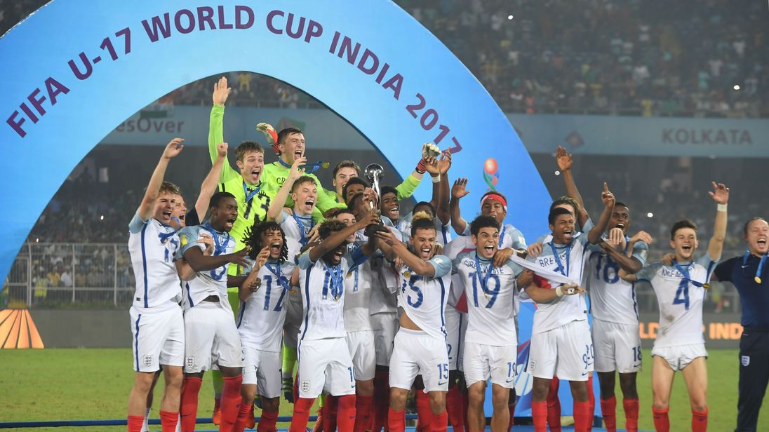 England's players celebrate with their trophy after their astonishing comeback win