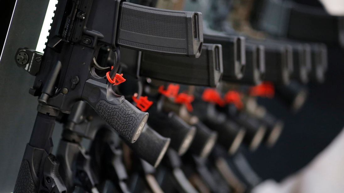 A row of rifles is seen on display at a National Rifle Association show