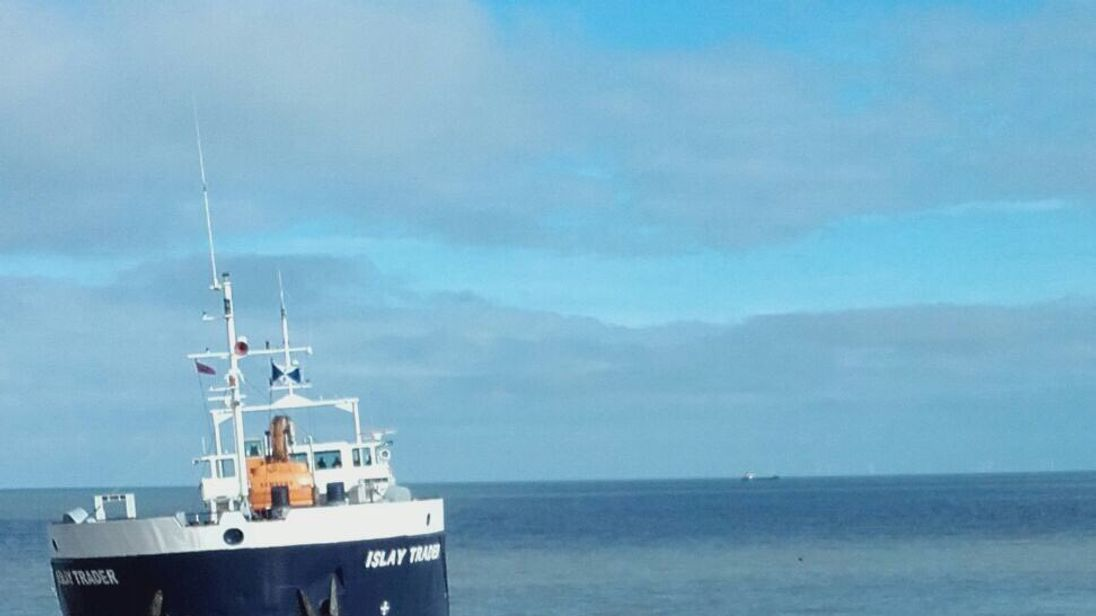 The Islay Trader aground beside a Gormley statue. Pic: Elizabeth Stone