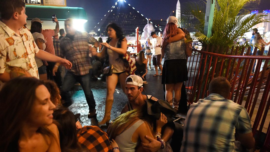 People flee as a gunman opens fire at a country music festival in Las Vegas