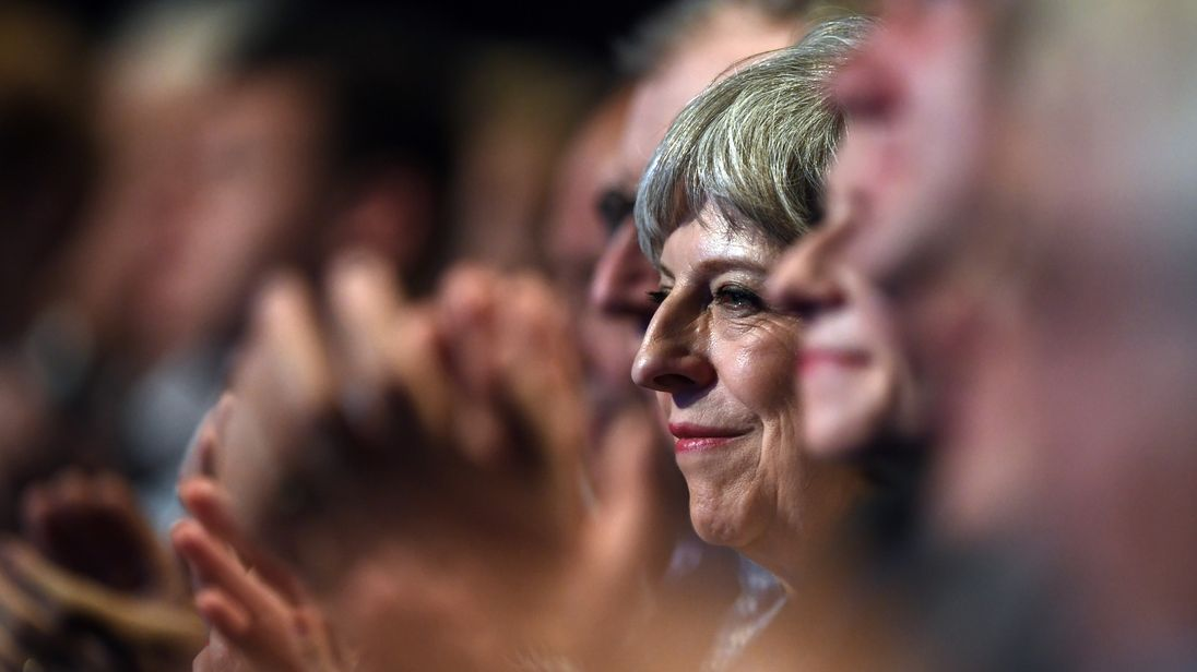 Britain's Prime Minister Theresa May applauds a speaker on the first day of the annual Conservative Party conference on October 1, 2017 in Manchester, England