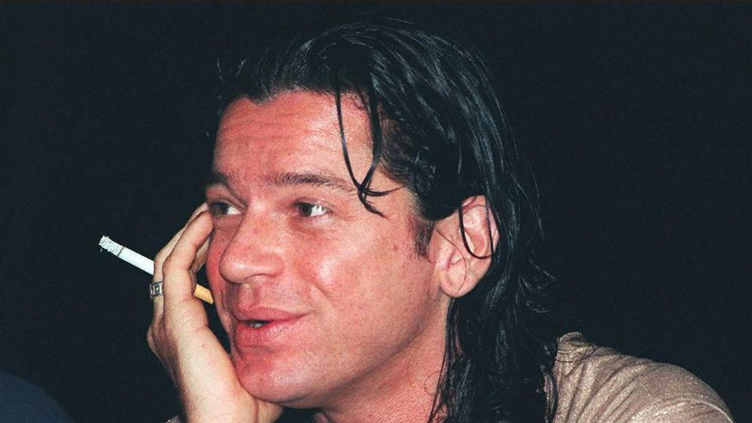 Michael Hutchence at a news conference the year before he died