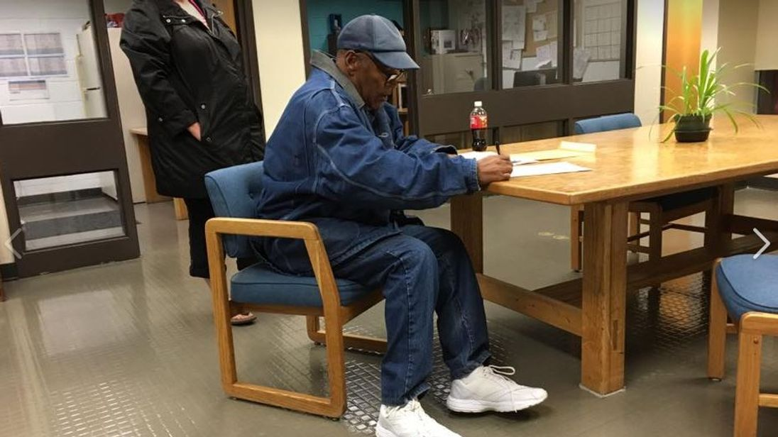OJ Simpson signing papers before his release on parole