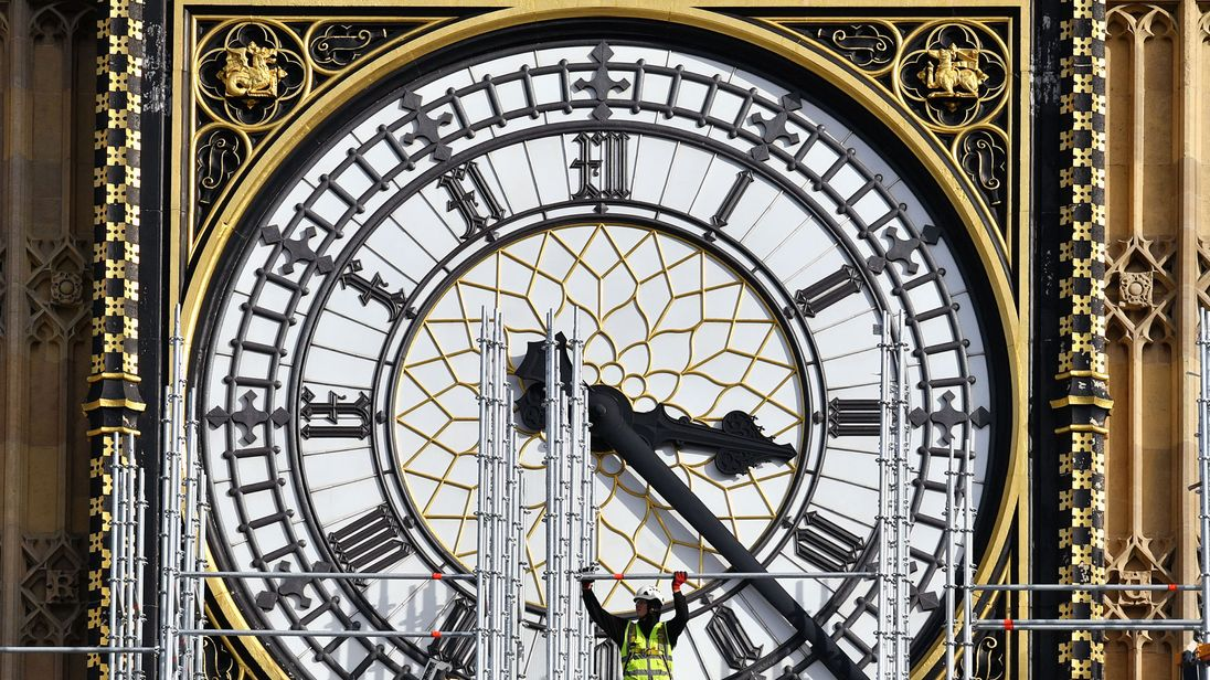 Construction workers build scaffolding around the Elizabeth Tower, also known as Big Ben, during ongoing conservation works at the Houses of Parliament, Westminster, London