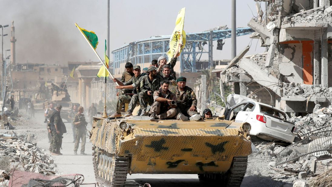 Syrian Democratic Forces (SDF) fighters celebrate victory in Raqqa