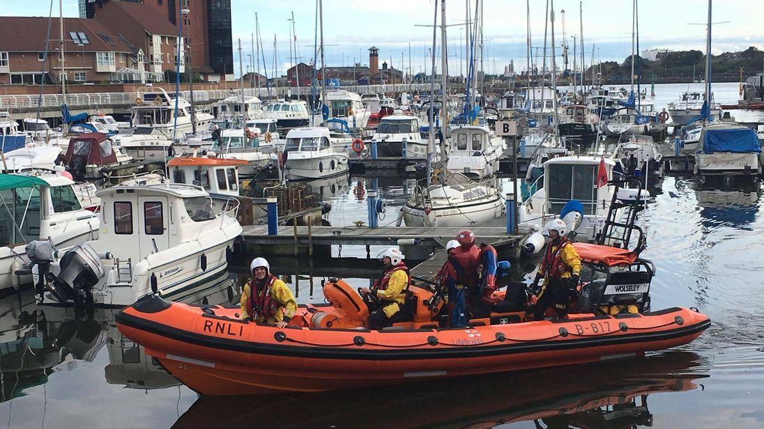 The Coastguard team brings the Marvel comic hero ashore. Pic: RNLI